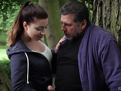 Outdoor fun in the park with a man authoritatively older than her