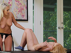 Busty teen lesbians Athena and Nikki take turns with a strap on