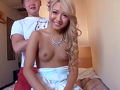 Blonde Japanese teen gets a cumshot on her small perky tits