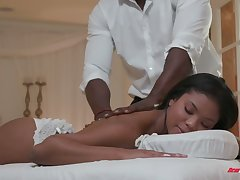 Mandingo fucks beautiful black client Nia Nacci exceeding the massage table