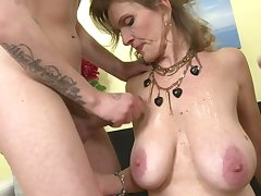 Adorable full-grown mom cum covered by two sons