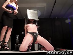 Mistress spanks a duteous teen in her dungeon