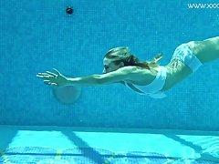 Nasty swimming girl Lindsay Cruz gets naked and shows tricks under the predominating