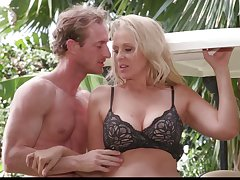 Mature blonde Julia Ann is cheating on her husband with muscular pasture boy